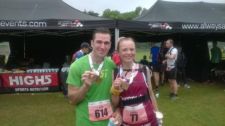 Fiona from Radcliffe AC with Rob Mills from Prestwich AC displaying medals