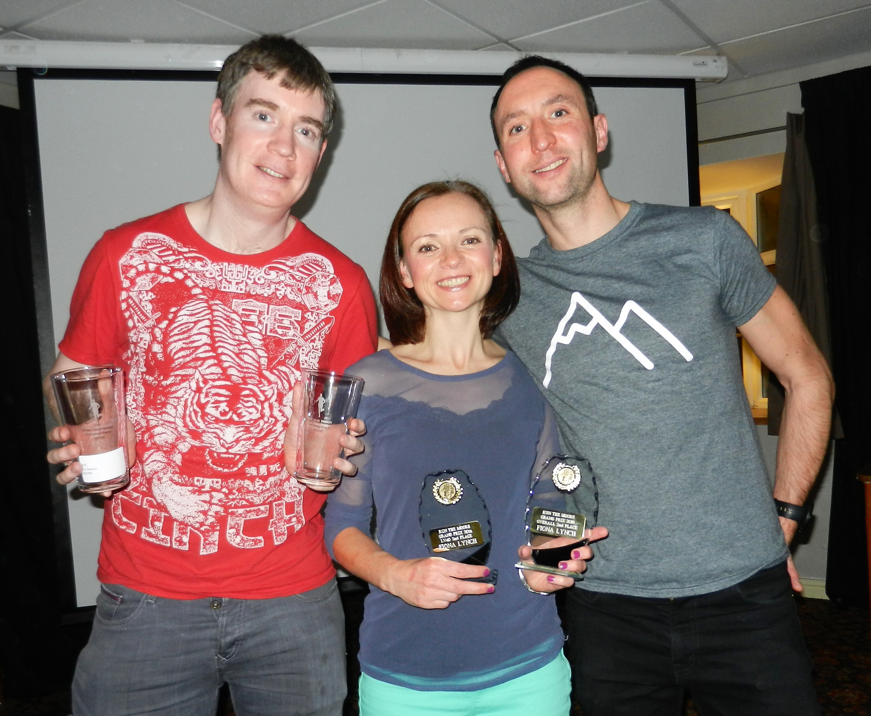 Chris, Fiona and speaker Ben Mounsey at the Grand Prix presentation.