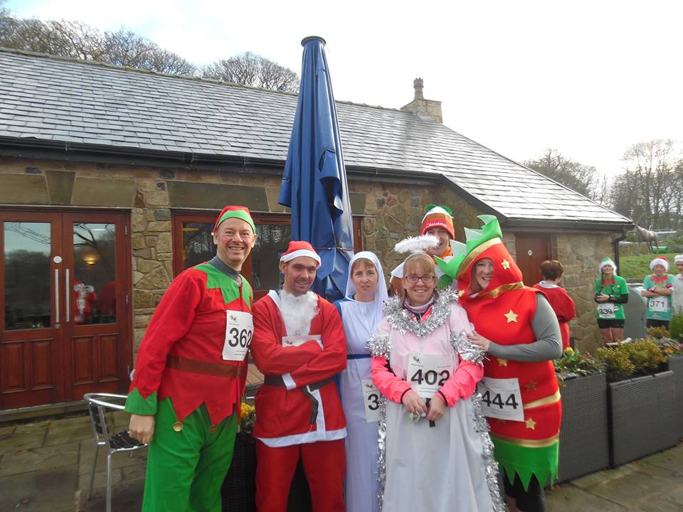 Radcliffe Runners in the Santa Dash.
