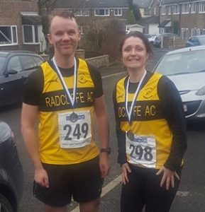 Kris and Caroline from Radcliffe running club show off their Stockport medals.