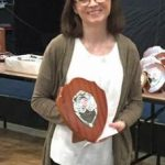 Fiona Radcliffe girl gets a shield at the cross country presentation.,