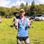 McKenzie Madison with his medal at the Brecon Beacons Ultra.