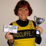 Vet-50 Jenny  taking a trophy and voucher prize at the Central Lancs 5k.
