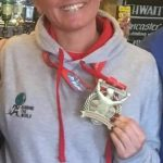 Nice medal for Sarah and a smile despite her knee troubles.