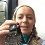 Michelle and her marathon medal.