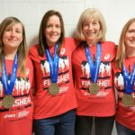 With their medals are Jen, Kate, Sheila and Sarah
