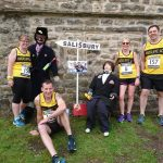 """Taking a look at the village """"characters"""" at the Wray Scarecrow 10k."""