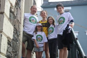 Fiona and husband Pete with Ewan, Niamh and Aoife in their special t-shirts at the Moot Hall.