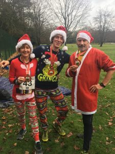 Kirsten Cook and Ian Harris (right) in fancy dress at the Christmas pudding dash.