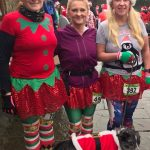 Getting festive (from left) Sharon Peterkin, Lisa Donnelly and Christine Berry at the Santa Dash.