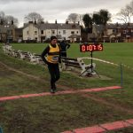Radcliffe runner Andy Wheeler crossing the finishing line at Smithy's.