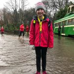 Olivia Whittaker at a wet Heaton parkrun.
