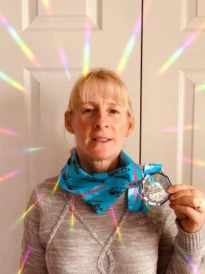 Kath Davies with her Spine medal